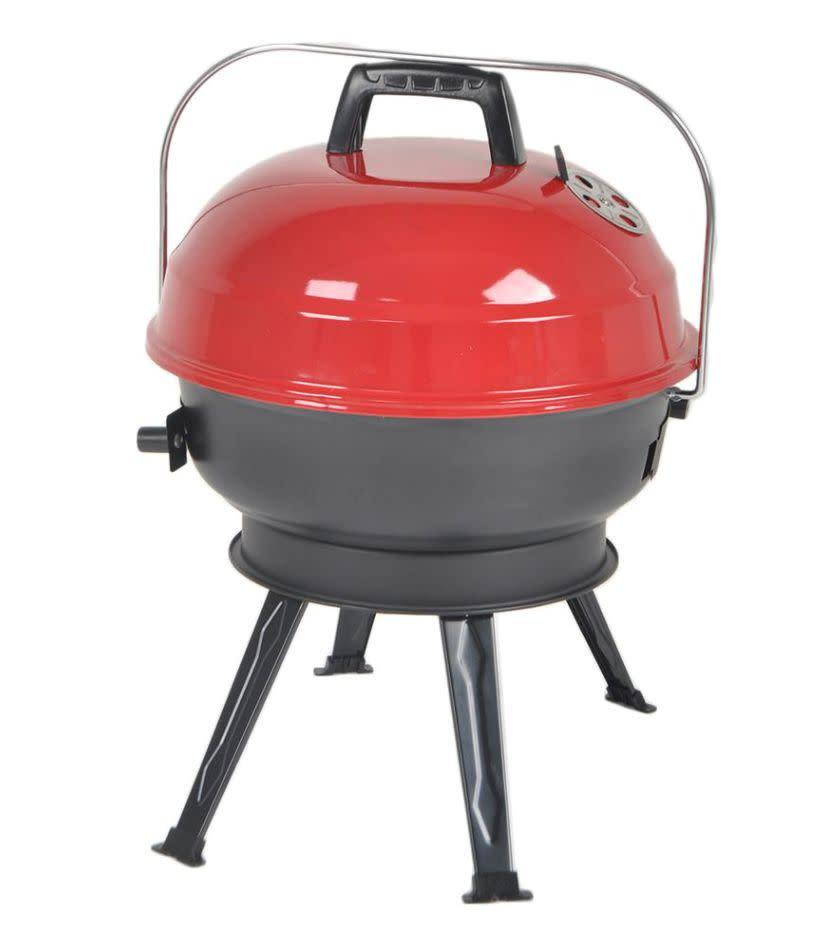 "The warming rack on this charcoal grill can cook up to eight burgers at one time. With legs that fold up, you can take this grill to a picnic and camping. <a href=""https://yhoo.it/2VxqKvo"" rel=""nofollow noopener"" target=""_blank"" data-ylk=""slk:Find it for $30 at Home Depot"" class=""link rapid-noclick-resp"">Find it for $30 at Home Depot</a>."