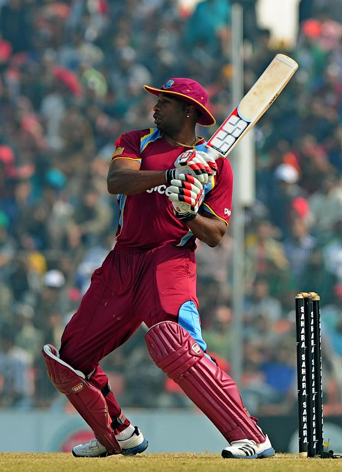 West Indies cricketer Kieron Pollard plays a shot during the first one day international cricket match between Bangladesh and The West Indies at The Sheikh Abu Naser Stadium in Khulna on November 30, 2012.  AFP PHOTO/ Munir uz ZAMAN