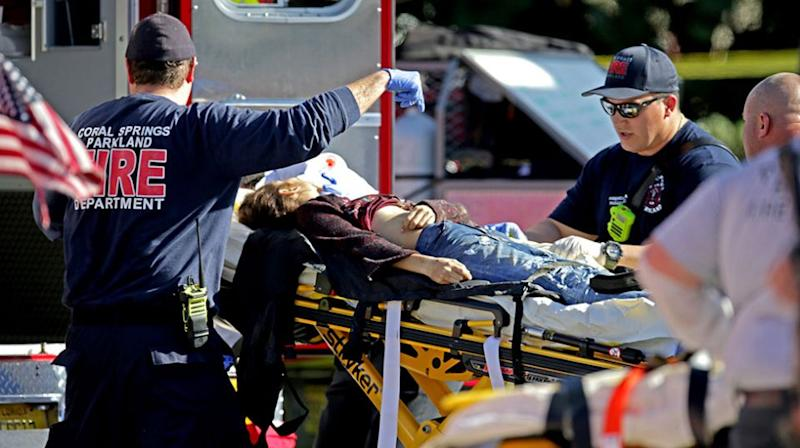 A woman is rushed from the school by paramedics. Source: Getty