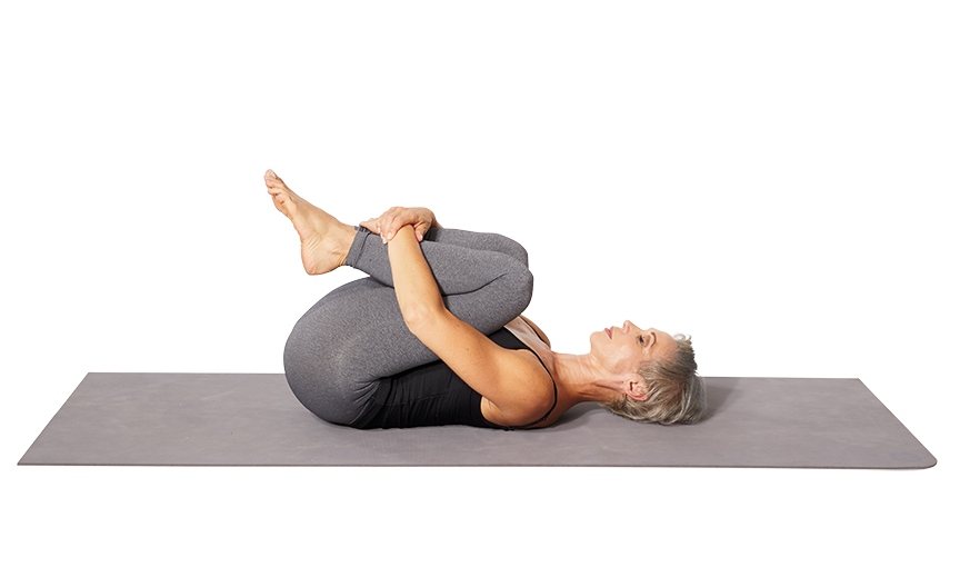 <p><strong>This move releases your lower back and hip tension. </strong></p><ol><li>Begin by lying on your back with your knees bent, feet flat on the floor, and arms at your side</li><li>With your hands either behind your thighs or slightly below your kneecaps, slowly bring both knees to toward your chest. Hold here for 20-30 seconds. </li><li>Try rocking your hips side to side to massage your lower back. Repeat this stretch 2 or 3 times.</li></ol>
