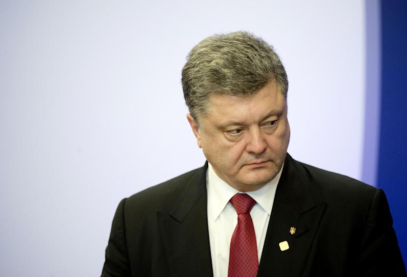 Ukrainian President Petro Poroshenko speaks during a press conference at the EU Headquarters in Brussels on February 12, 2015