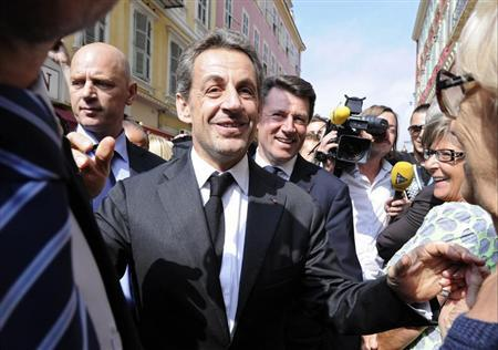Former French president Sarkozy greets well-wishers as he arrives for a lunch with UMP political party members in Nice
