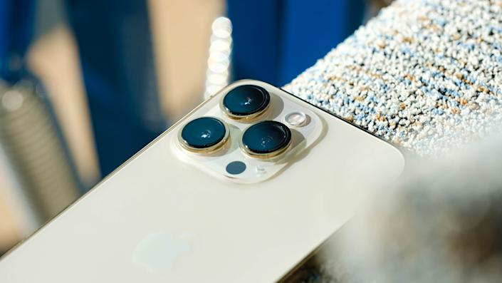 Close up of the gold iPhone 13 Pro's triple rear cameras