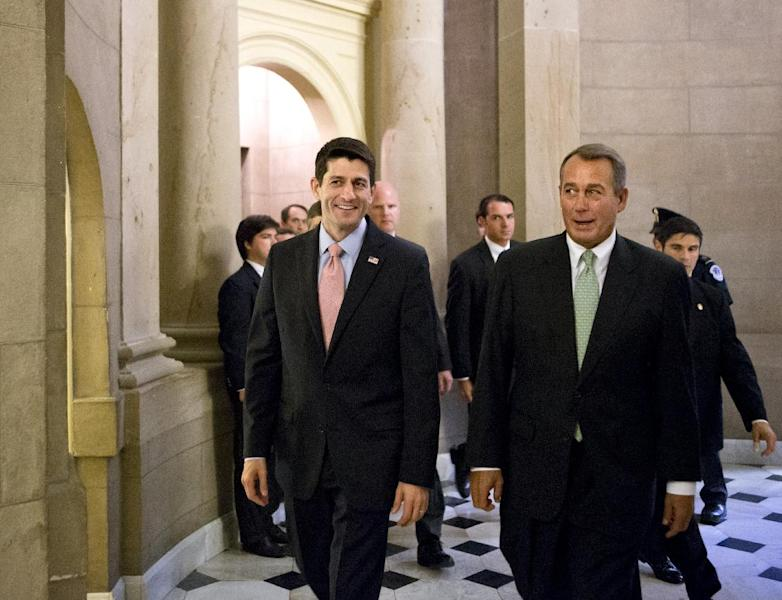 Walking with House Speaker John Boehner, R-Ohio, right, Rep. Paul Ryan, R-Wis., left, the Republican vice presidential candidate, returns to Capitol Hill to vote on a stopgap spending bill that avoids a government shutdown but carries a price tag $19 billion higher than the budget he wrote as chairman of the House Budget Committee, in Washington, Thursday, Sept. 13, 2012. (AP Photo/J. Scott Applewhite)