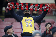 AC Milan's supporter wears a jersey Kobe Bryant prior to the start of the Italian Cup soccer match between AC Milan and Torino in Milan, Italy, Tuesday, Jan. 28, 2020. Bryant, an 18-time NBA All-Star with the Los Angeles Lakers and a lifelong soccer fan, died Sunday with his 13-year-old daughter, Gianna, in a helicopter crash near Calabasas, California. He was 41. (AP Photo/Antonio Calanni)