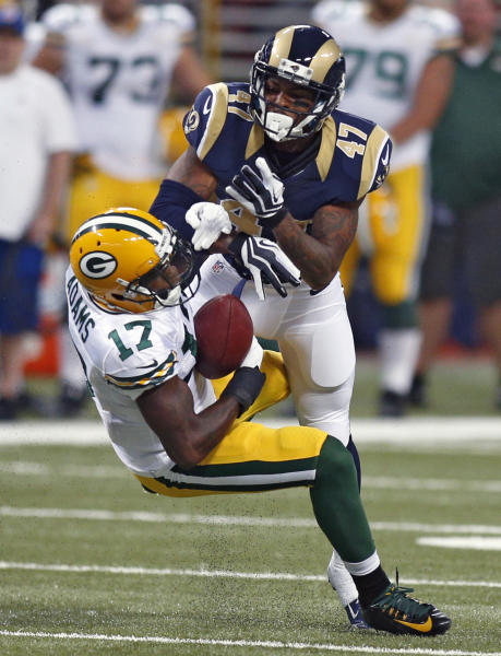 Green Bay Packers wide receiver Davante Adams (17) catches a 14-yard pass as St. Louis Rams cornerback Marcus Roberson defends during the third quarter of an NFL preseason football game Saturday, Aug. 16, 2014, in St. Louis. (AP Photo/Scott Kane)