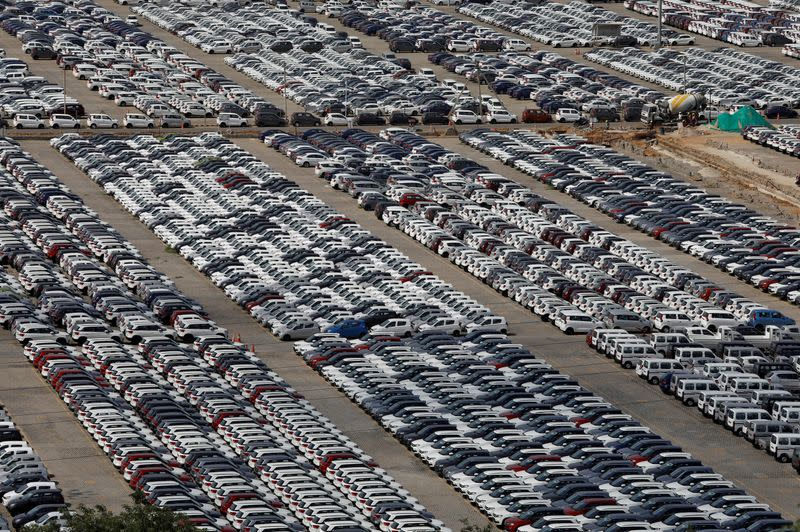 Cars are seen parked at Maruti Suzuki's plant at Manesar