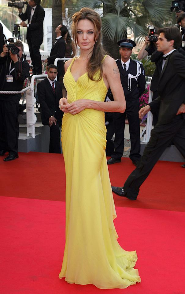 """6. 60th Annual Cannes Film Festival <a href=""""http://movies.yahoo.com/movie/1809699091/info"""">Ocean's Thirteen</a> premiere (2007)   Fashion critics -- who had grown tired of seeing Angelina in nothing but black -- swooned when they saw the sultry star slink her way down the red carpet in Cannes in this yummy yellow Emanuel Ungaro gown."""