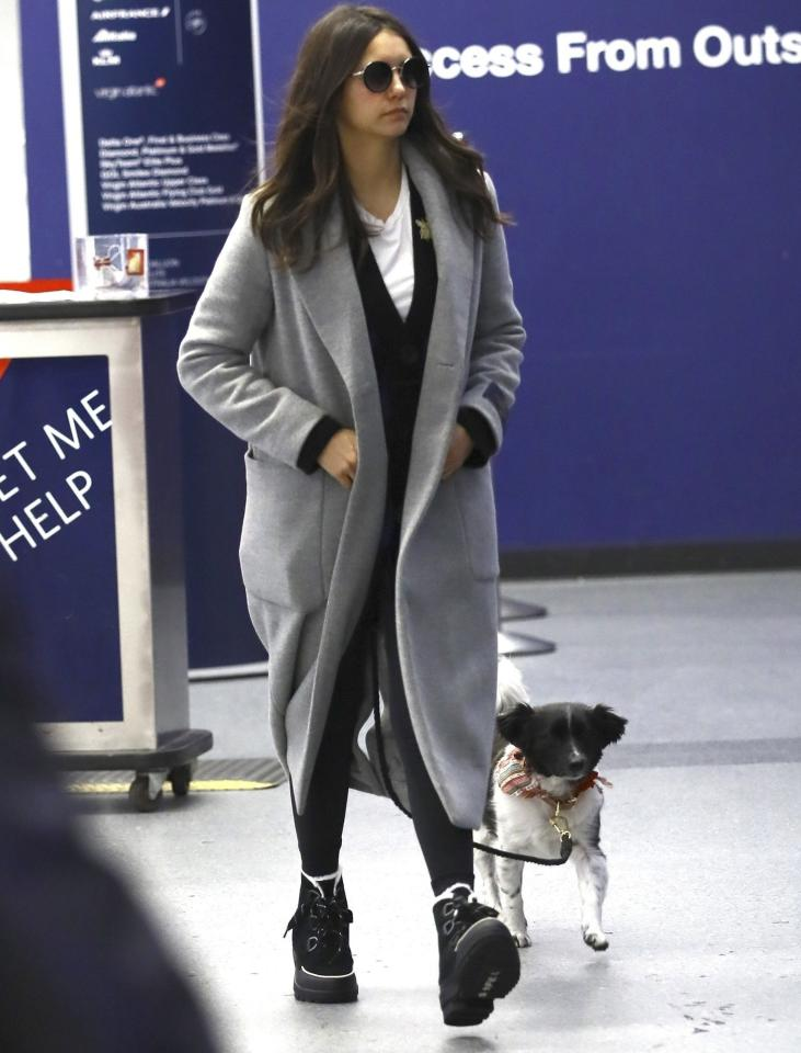 Nina Dobrev catches a flight out of LAX on Monday.