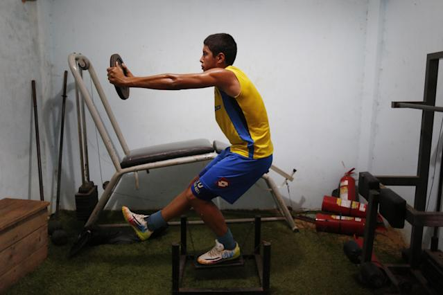In this Oct. 18, 2014 photo, soccer player Nestor Gonzalez from the Deportivo Capiata team trains in Capiata, Paraguay. Capiata will face Argentina's Boca Juniors in a second leg of the Copa Sudamericana tournament on Thursday, Oct. 23 with the winner going to the quarterfinals of Latin America's No. 2 club tournament. Capiata won the first leg game on Oct. 15. (AP Photo/Jorge Saenz)