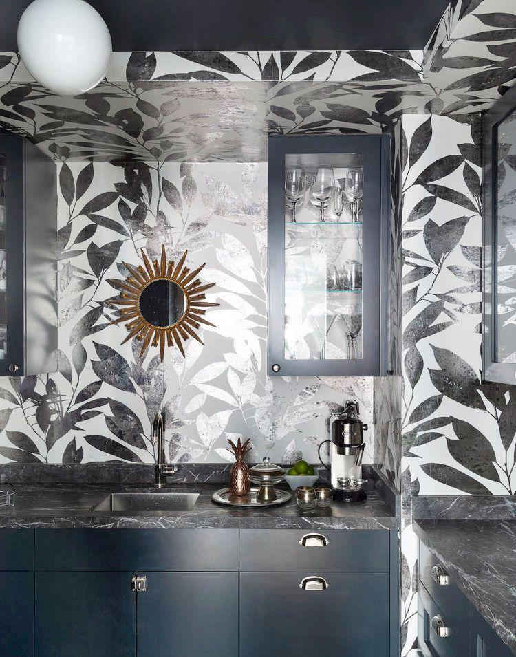 """<p>Metallic wallpaper is the perfect backdrop for a moody, intimate home bar or wine cellar. <a href=""""https://www.studiodb.com/"""" rel=""""nofollow noopener"""" target=""""_blank"""" data-ylk=""""slk:Studio DB"""" class=""""link rapid-noclick-resp"""">Studio DB</a> paired it with black marble surfaces and stained wood cabinets to finish the look. And, of course, don't forget to keep glasses in the area for tastings. </p>"""