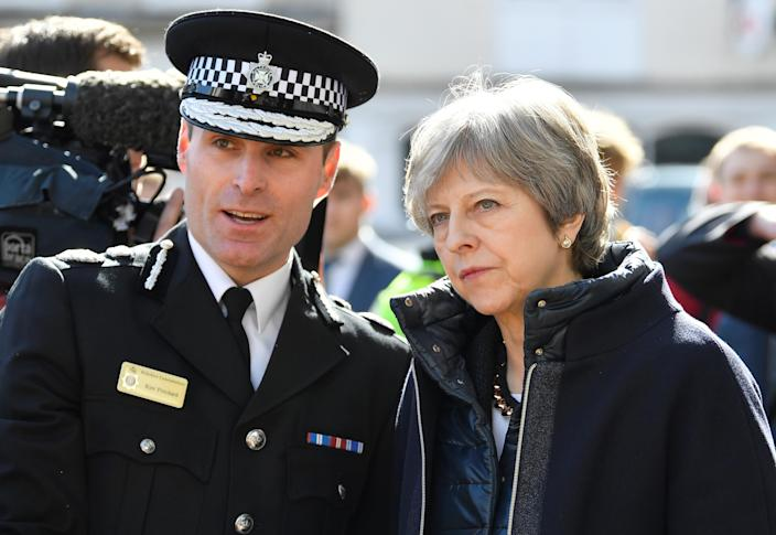 U.K. Prime Minister Theresa May visits Salisbury on March 15, where former Russian intelligence officer Sergei Skripal and his daughter, Yulia, were poisoned. (Toby Melville/Pool/Reuters)