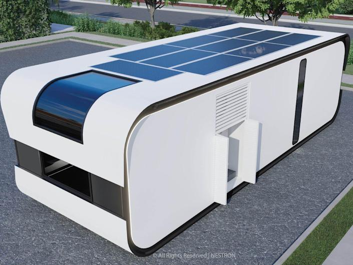 exterior of the one-bedroom Cube Two X with solar panels on the roof
