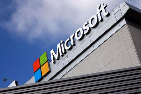 FILE PHOTO: A Microsoft logo is seen a day after Microsoft Corp's (MSFT.O) $26.2 billion purchase of LinkedIn Corp (LNKD.N), in Los Angeles