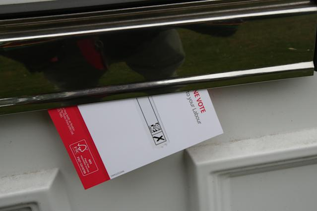 A file image of a Labour Party leaflet posted through a door. Labour activist Bob Thomson was attacked on Sunday after posting a leaflet - but returned to the campaign trail on Wednesday (PA)