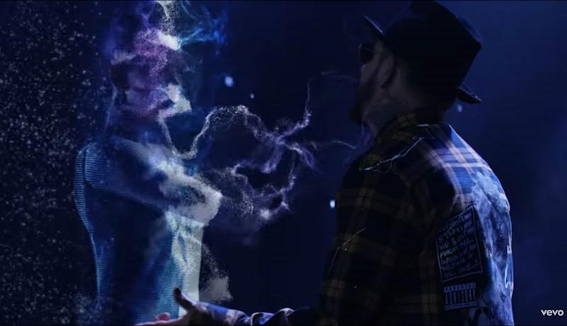 A.J. McLean does his best to serenade what appears to be a hologram of a very attractive woman