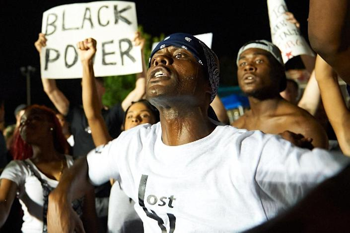 Demonstrators took to the streets of Ferguson to mark the anniversary of 18-year-old Michael Brown's death in a fateful encounter on August 9, 2014 with officer Darren Wilson (AFP Photo/Michael B. Thomas)