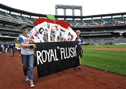 Sam Gable, left, and Al Gable, from Nyack, N.Y., carry their banner around the field during Banner Day before the baseball game between the New York Mets and the Pittsburgh Pirates at Citi Field on Saturday, May 11, 2013 in New York. (AP Photo/Kathy Kmonicek)