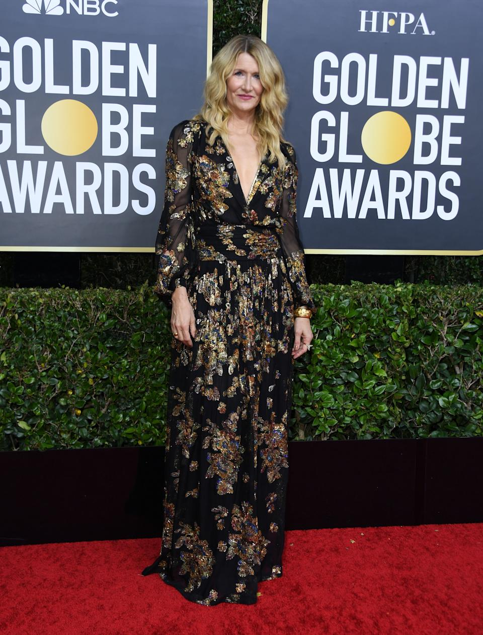 """The """"Marriage Story"""" and """"Little Women"""" star wore a bohemian-inspired gown by Saint Laurent. (Photo by VALERIE MACON/AFP via Getty Images)"""