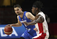 Canada's Luguentz Dort holds off Czech Republic's Tomas Satoransky during the first half of a FIBA men's Olympic basketball qualifying semifinal at Memorial Arena in Victoria, British Columbia, Saturday, July 3, 2021. (Chad Hipolito/The Canadian Press via AP)