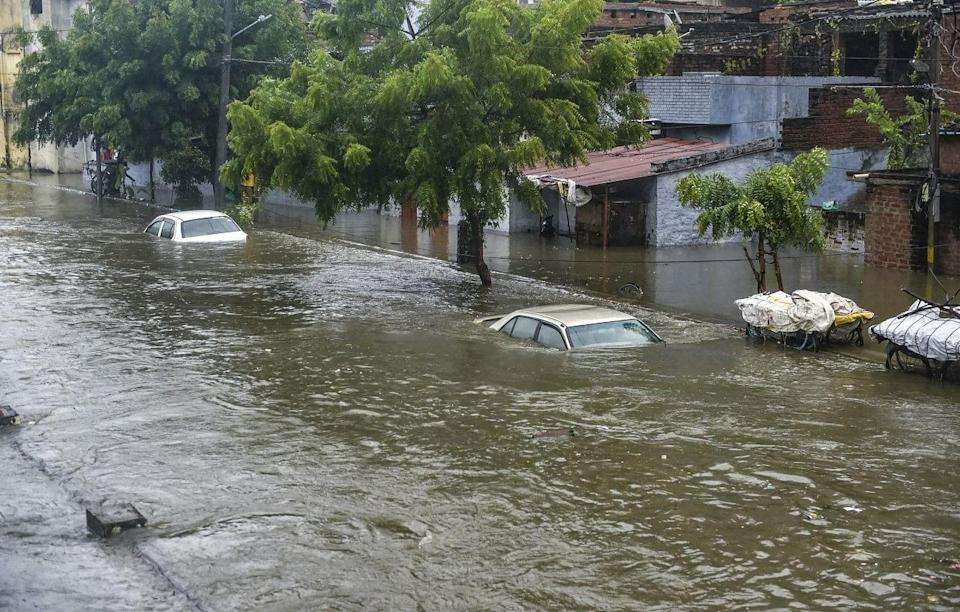"""<div class=""""paragraphs""""><p>Lucknow: Partially submerged vehicles due to waterlogging following heavy rains in Lucknow, 16 September</p></div>"""