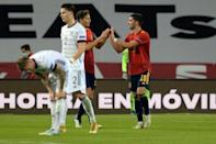 Ferran Torres (R) celebrates after completing his hat-trick in Spain's stunning 6-0 win over Germany