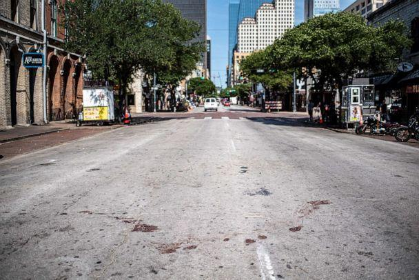 PHOTO: The street is stained with blood near the scene of a shooting in Austin, Texas, June 12, 2021.  (Sergio Flores/Getty Images)