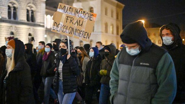 PHOTO: People take part in a protest after Swiss voters narrowly approved a measure that bans full-face coverings in public, in Bern, Switzerland, on March 7, 2021. (Fabrice Coffrini/AFP via Getty Images)