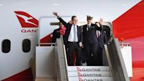 Qantas CEO Alan Joyce and crew members of flight QF7879, which flew direct from London to Sydney, disembark the plane during the Qantas Centenary Launch at Qantas Sydney Jet Base in Sydney