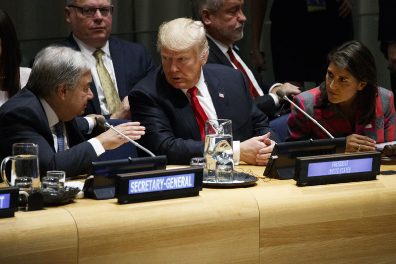 President Donald Trump, center, and U.S. Ambassador to the United Nations Nikki Haley, right, talk with United Nations Secretary General Antonio Guterres at the United Nations General Assembly, Monday, Sept. 24, 2018, at U.N. Headquarters. (AP Photo/Evan Vucci)