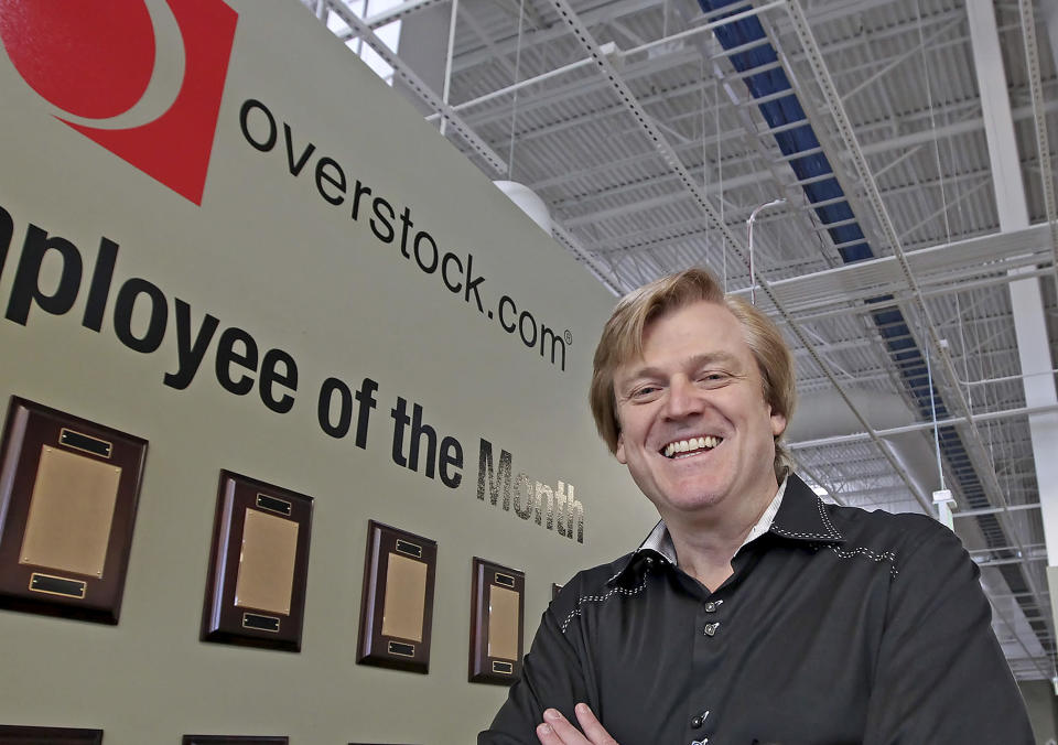 FILE - This March 25, 2010 file photo, Chairman and CEO of OverStock.com Patrick Byrne poses for a picture by the employee of the month wall at the warehouse of Overstock.com outside of Salt Lake City. Election officials and experts are raising alarms about the private fundraising surrounding efforts to expand Republican ballot reviews to more states former President Donald Trump falsely claims he won. While some fundraising details have come to light, information about who is donating the money and how it's being spent is largely exempt from public disclosure. (AP Photo/George Frey, File)