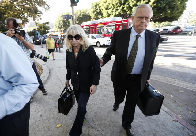 Shelly Sterling, 79, (L) arrives at court with her lawyer Pierce O'Donnell in Los Angeles, California July 7, 2014. The $2 billion sale of the NBA's Los Angeles Clippers faces a key legal hurdle on Monday as the estranged husband and wife who own the franchise battle in court over control of the team. Shelly Sterling, 79, has asked a Los Angeles judge to confirm her as having sole authority to sell the pro basketball franchise to former Microsoft Corp chief executive Steve Ballmer at an NBA-record price after husband Donald Sterling vowed to block the deal. REUTERS/Lucy Nicholson (UNITED STATES - Tags: CRIME LAW SPORT BASKETBALL BUSINESS)