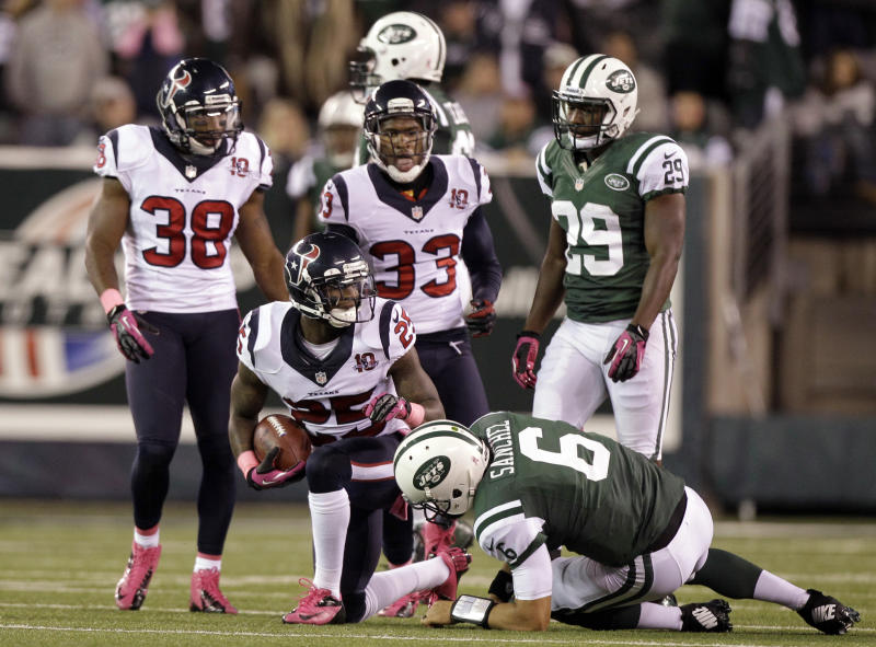 In this photo taken Oct. 8, 2012, Houston Texans defensive back Kareem Jackson  (25) gets up after returning an interception against New York Jets quarterback Mark Sanchez (6) late in the second half of an NFL football game in East Rutherford, N.J. Jackson interception helped sealed the Texans 23-17 victory. (AP Photo/Kathy Willens)
