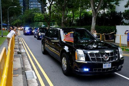 The motorcade of U.S. President Donald Trump travels towards Sentosa for his meeting with North Korean leader Kim Jong Un, in Singapore June 12, 2018. REUTERS/Feline Lim