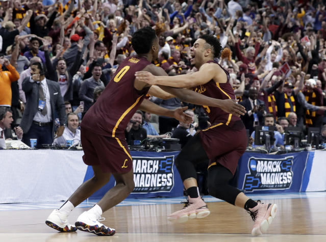Loyola-Chicago guard Donte Ingram (0) and Marques Townes, right, celebrate their 64-62 win over Miami in a first-round game at the NCAA college basketball tournament in Dallas, Thursday, March 15, 2018. (AP Photo/Tony Gutierrez)