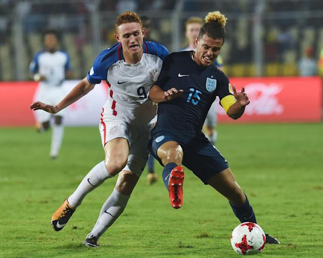 United States striker Josh Sargent (9) battles England's Joel Latibeaudiere on Saturday in Goa, India. (Getty)