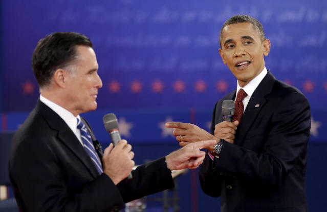 <p>President Barack Obama, right, and Republican presidential candidate, former Massachusetts Gov. Mitt Romney exchange views during the second presidential debate, Oct. 18, 2012, at Hofstra University in Hempstead, N.Y. (AP Photo/David Goldman) </p>