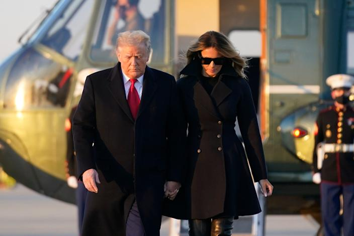 President Donald Trump and first lady Melania Trump board Air Force One at Andrews Air Force Base in Maryland on Dec. 23, 2020.