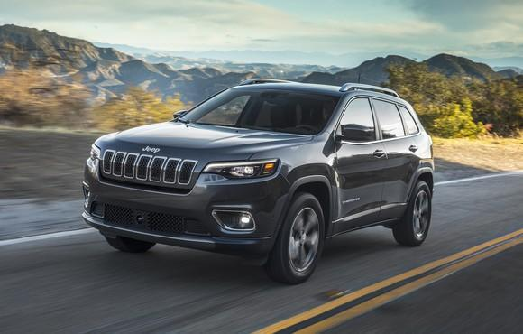 A 2019 Jeep Cherokee, a midsize crossover SUV, on a country road.