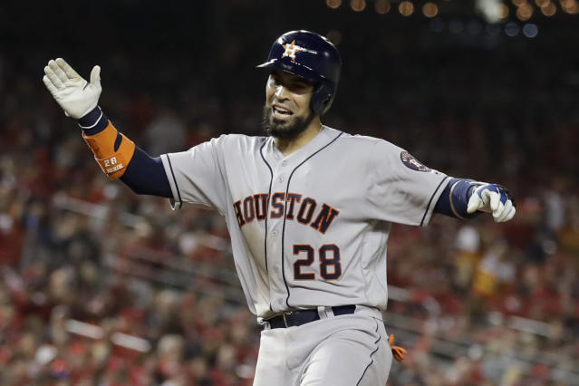 Houston Astros' Robinson Chirinos celebrates after his home run against the Washington Nationals during the sixth inning of Game 3 of the baseball World Series Friday, Oct. 25, 2019, in Washington. (AP Photo/Jeff Roberson)