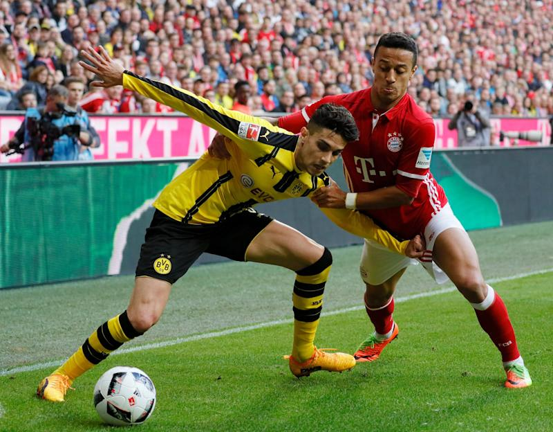 Bayern's Thiago (R) in action against Dortmund's Marc Bartra (L) during the German Bundesliga soccer match between FC Bayern Munich and Borussia Dortmund in Munich, Germany, 08 April 2017. EPA/RONALD WITTEK (EMBARGO CONDITIONS - ATTENTION: Due to the accreditation guidelines, the DFL only permits the publication and utilisation of up to 15 pictures per match on the internet and in online media during the match - Credit: RONALD WITTEK/EPA
