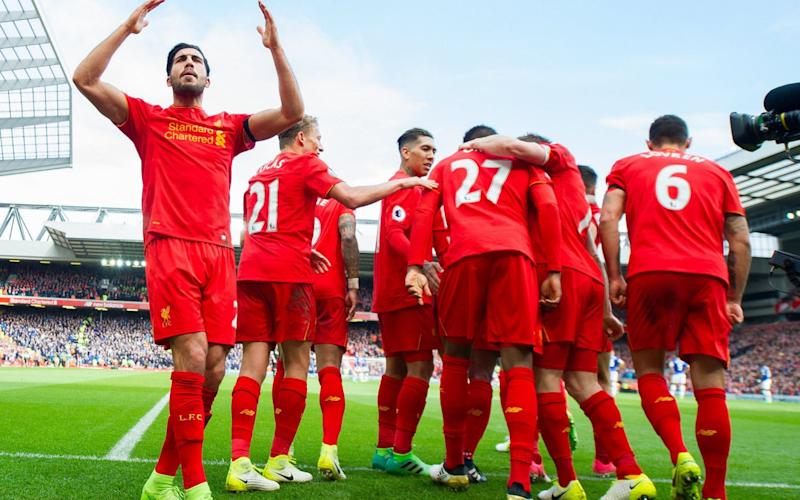 Emre Can celebrates as Liverpool look for one final push to the season - EPA