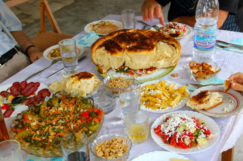 This Aug. 17, 2012 photo released by Mikhail Iliev shows a traditional Bulgarian feast, including shopska salad, lower right, a salad of peppers, lower left, and a bread with feta cheese called pogatcha in Bulgaria. (AP Photo/Mikhail Iliev)