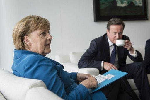 This picture released by the German government press office shows German Chancellor Angela Merkel and British Prime Minister David Cameron at the chancellery in Berlin. Merkel pushed for a stronger European political union amid growing international calls for action as a brutal Spain ratings downgrade added another twist to the eurozone crisis