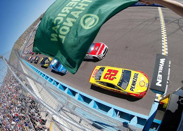<p>oey Logano, driver of the #22 Shell Pennzoil Ford, taks the green flag to start the Monster Energy NASCAR Cup Series Camping World 500 at Phoenix International Raceway in Avondale, Arizona. </p>