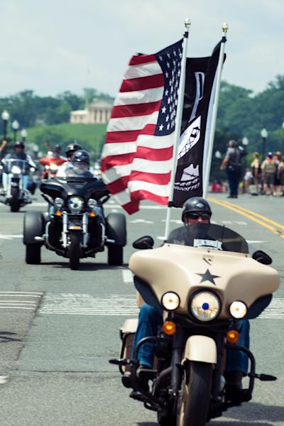 "A biker flies the flags of the United States and another one honoring soldiers held prisoner or missing, during the annual ""Rolling Thunder"" ride in Washington (AFP Photo/Eric BARADAT)"