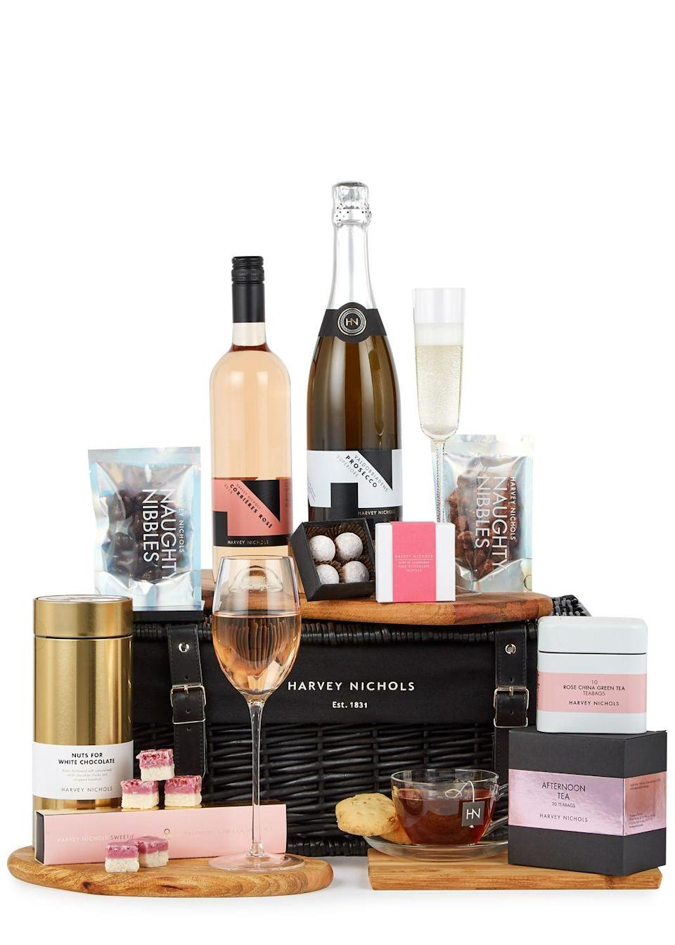 "<p>For a dreamy picnic à deux, look to Harvey Nichols' All Things Nice hamper. It contains a selection of luxury nibbles, a bottle of Prosecco and the store's bestselling rosé, as well as afternoon teas and Marc de Champagne pink chocolate truffles.</p><p>£85, Harvey Nichols</p><p><a class=""link rapid-noclick-resp"" href=""https://www.harveynichols.com/brand/harvey-nichols/3224867-all-things-nice-hamper/p3836354/"" rel=""nofollow noopener"" target=""_blank"" data-ylk=""slk:SHOP NOW"">SHOP NOW</a></p>"