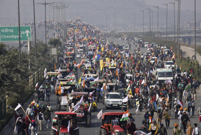 Farmers participate in a protest march towards the capital during India's Republic Day celebrations in New Delhi, India, Tuesday, Jan. 26, 2021. Tens of thousands of farmers drove a convoy of tractors into the Indian capital as the nation celebrated Republic Day on Tuesday in the backdrop of agricultural protests that have grown into a rebellion and rattled the government. (AP Photo/Dinesh Joshi)