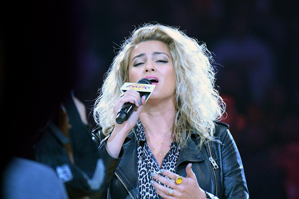Tori Kelly sings the national anthem before an NBA basketball game between the Los Angeles Lakers and Denver Nuggets, Dec. 22, 2019, in Los Angeles.