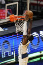 Dallas Mavericks forward Tim Hardaway Jr., dunks the ball during the second half of an NBA basketball game against the Miami Heat, Tuesday, May 4, 2021, in Miami. (AP Photo/Wilfredo Lee)